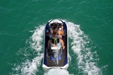 Overhead view of a young man and woman riding tandem on a jet ski