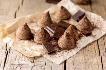 Homemade Tasty Chocolate Truffle Candy on the Old Wooden Background Tasty Candy