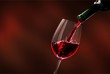 Quadro Red wine being poured in wineglass, closeup