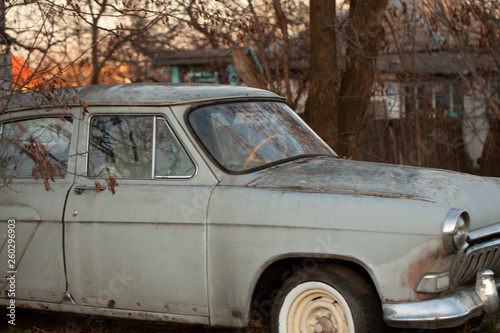 Photo of one old car in the village