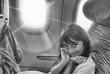 Happy young girl during a long flight - 260311945