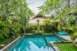 Garden on back yard with swimming pool