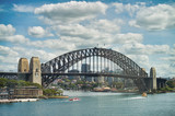 SYDNEY - OCTOBER 2015: Panoramic view of Sydney Harbor on a sunny day. The city attracts 20 million people annually - 260313167