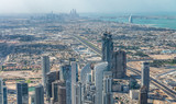 Amazing aerial view of Downtown Dubai and Marina on the background