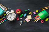 School supplies background flat lay on blackboard, back to school concept