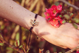 Lotus metal component labradorite stone bracelet on female wrist