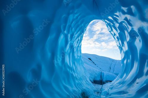 Leinwandbild Motiv Entrance of large ice cave on the Matanuska Glacier in the Alaskan Wilderness
