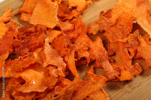 pumpkin chips lying on the table - 260331159