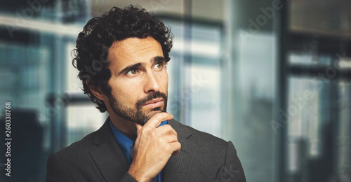 Young businessman in a thoughtful expression © Minerva Studio