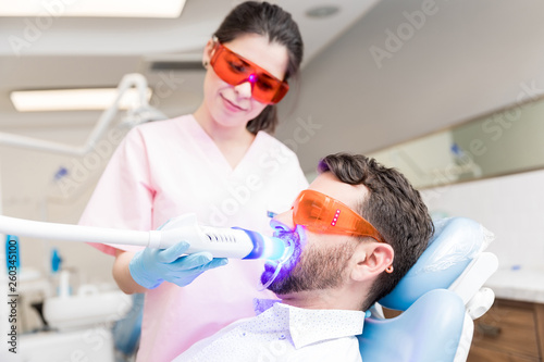Patient Receiving Dental Treatment From Dentist - 260345100