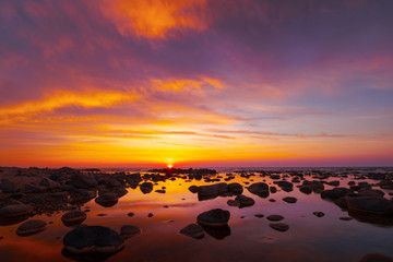 Beautiful sunset at sea side with stones © Anton Gvozdikov