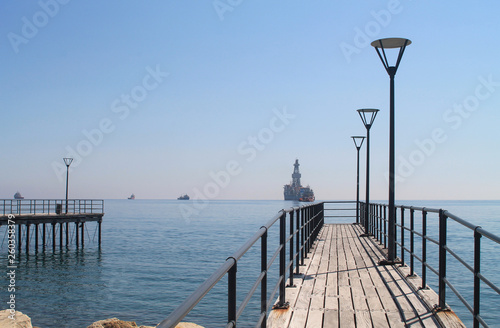 Sea pier with street lamps  © Olga