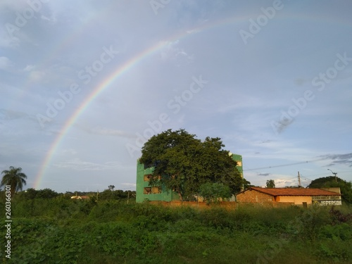rainbow over village © Paulo