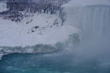 Ice several feet thick at the base of the american side of the Niagara waterfalls as seen from the Canadian side