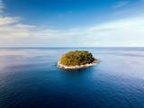 Little uninhabited island in ocean