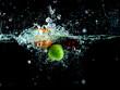Splashing fruit into water. - 260431531
