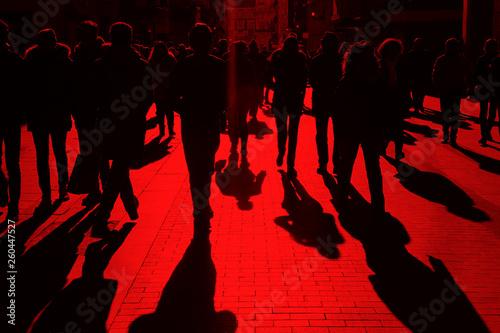 fototapeta na ścianę People on the street. Urban crowd in red tone. Horizontal
