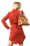 Female wearing red dress holding bag