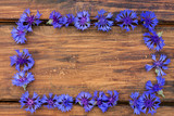 Cornflowers close-up on wooden background