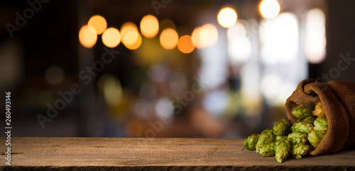Beer barrel with beer glass on table on wooden background - 260493146