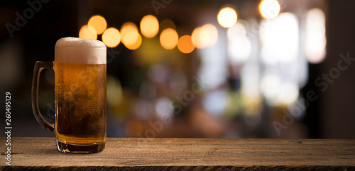 Beer barrel with beer glass on table on wooden background - 260495129