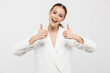Beautiful happy woman posing isolated over white wall background showing thumbs up.