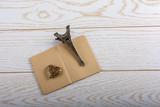 Fototapeta Fototapety z wieżą Eiffla - Eiffel tower miniature and a steel heart on a brown notebook on wooden background © berkay08