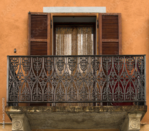 A fretwork balcony on the antic house of Italy
