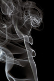 curls of white smoke isolated on black