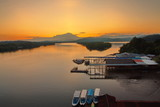 Scenery of beautiful sunrise with river and mountain in Borneo Asia