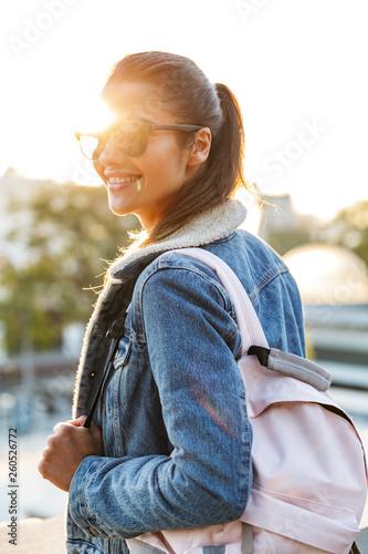 Leinwanddruck Bild Beautiful young woman wearing jacket