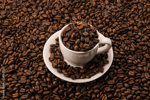Coffee beans in white coffee cup on the roasted coffee beans © Андрей Шнайдер