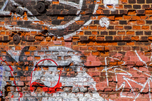Background image in the form of a fragment of an old red brick wall with traces of erosion painted with abstract patterns of different colors - 260539536