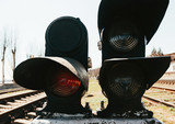 traffic lights for trains are lit in red