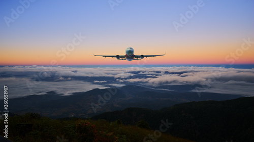 airplane on the skyline and sunrise landscape cloud and hill - 260551907