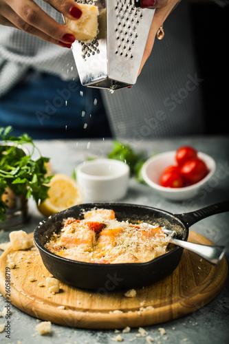 Young woman prepares a delicious pasta with salmon © Belokoni Dmitri