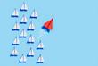 Leinwandbild Motiv Roter Papierflieger bei Kurswechsel - Durchstarten 2