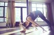Leinwanddruck Bild - yoga balance girl / Yoga coach shows balance, yoga postures. Beautiful sporty graceful girl in the gym
