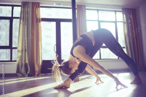 Leinwandbild Motiv yoga balance girl / Yoga coach shows balance, yoga postures. Beautiful sporty graceful girl in the gym