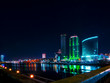 Colorful cityscape of Yekaterinburg at night reflecting in water