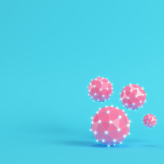 Pink low poly abstract glowing spheres on bright blue background in pastel colors