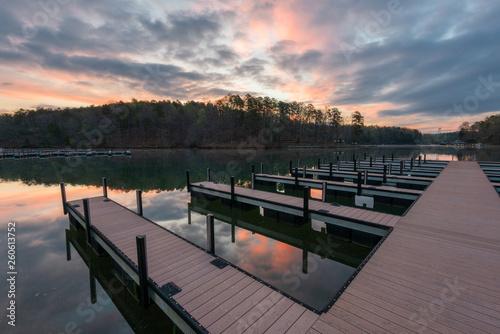 Acrylglas Pier dock on lake during colorful sunrise
