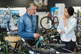 man and woman in bike shop