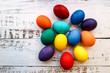 Several colorful easter eggs on wooden table background