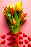 Fototapeta Tulipany - Bouquet of colorful tulips and small red hearts © digieye