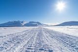 Ski-doo and cross country skitrail on a lake toward the Ahkka mountain. Lapland,  Sweden.
