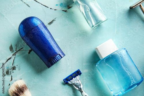 Leinwandbild Motiv Razor with cosmetics on color background