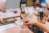 waiter serving red wine in restaurant