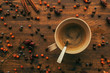 Top view of coffee cup and spoon