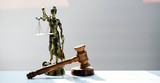 Statue of blind goddess Themis on blurred background